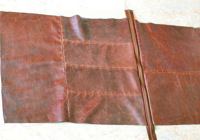 pieces of leather bag laid out