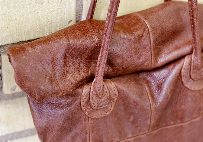 leather bag top. close up of handles