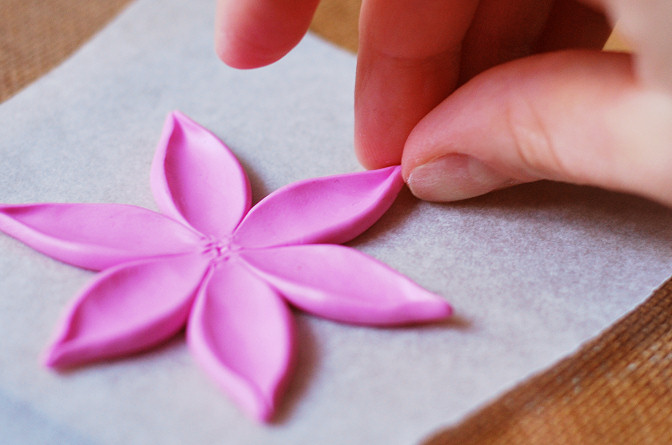 push in the ends of the petals