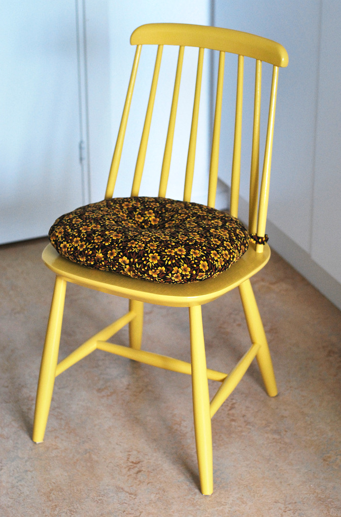 yellow chair with vintage fabric cushion